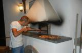 A local pizza artisan demonstrating the fine art of pizza making to SlowGlobe foodies